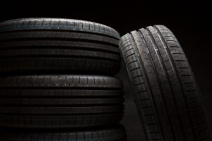 Stack of brand new high performance car tires on clean high-key